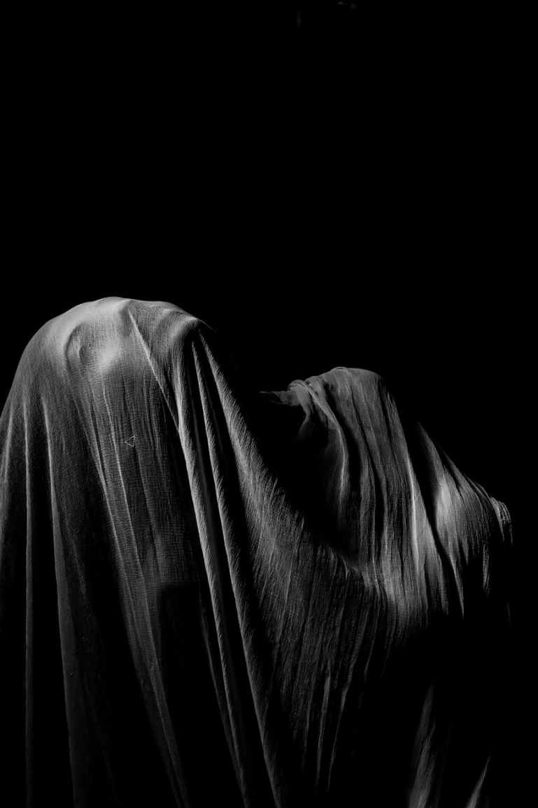 person s body covered with cloth