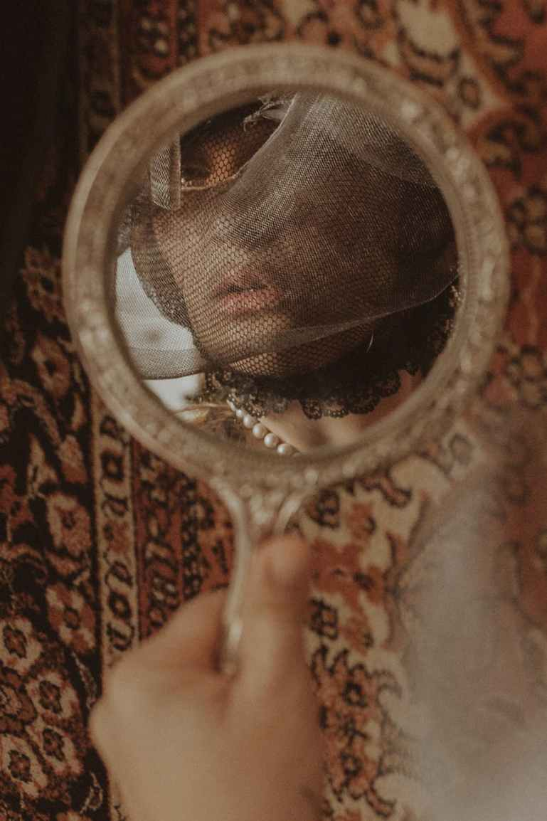 woman looking to a mirror
