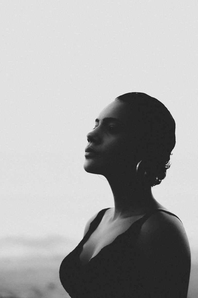 woman looking sideways in grayscale photo