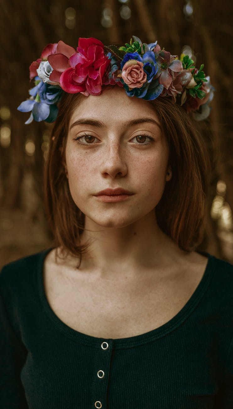 close up photo of woman wearing floral headdress