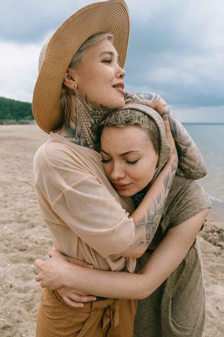 women hugging each other