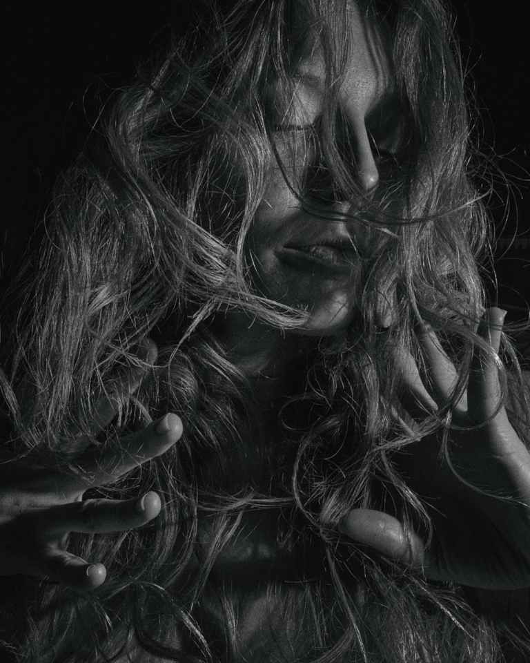 grayscale photo of woman with hair on her face