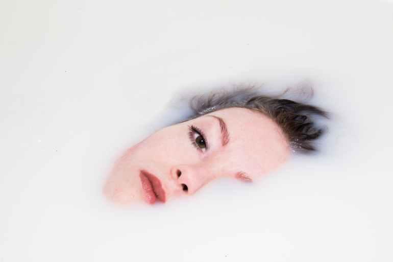 woman s face on white liquid