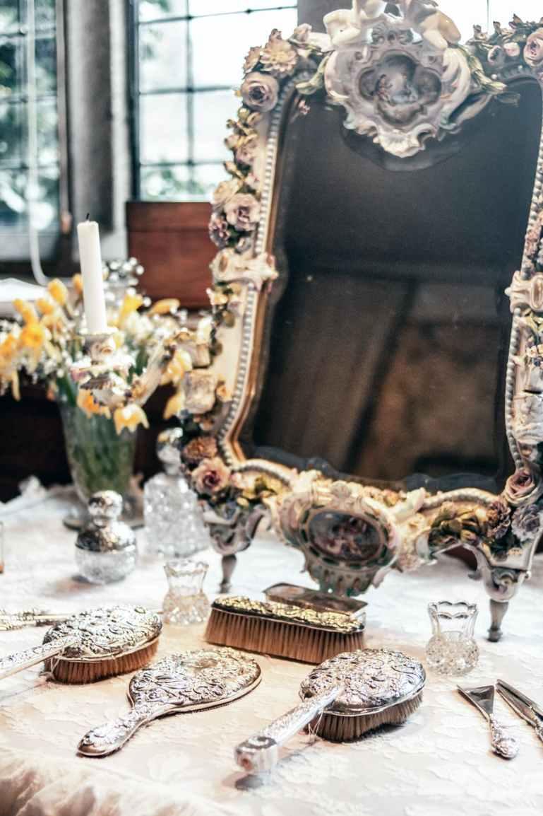 gray decor lot near brown framed mirror