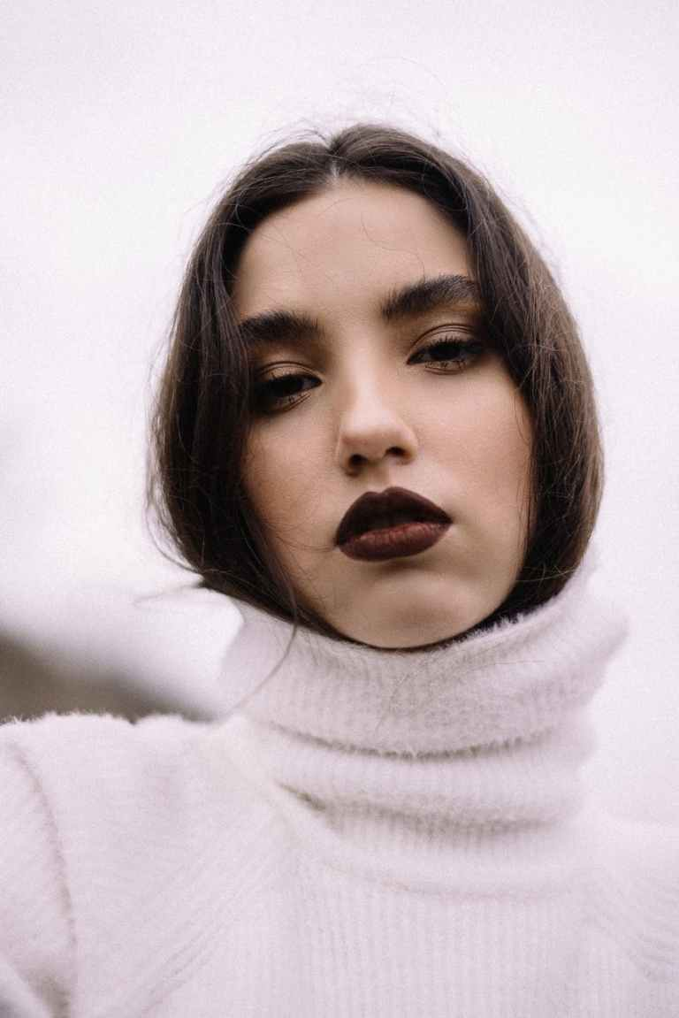 woman wearing white turtleneck sweater