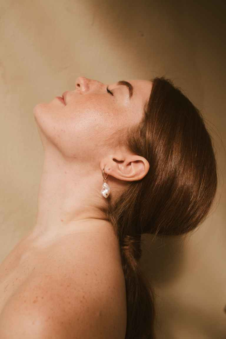 woman wearing silver stud earring