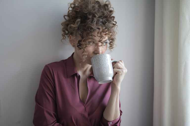 woman drinking coffee at home in solitude
