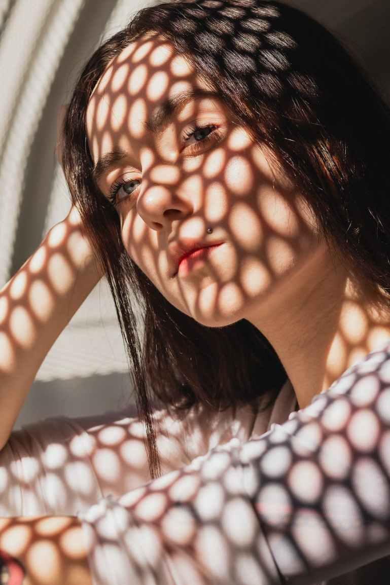 sunlight hitting woman s face