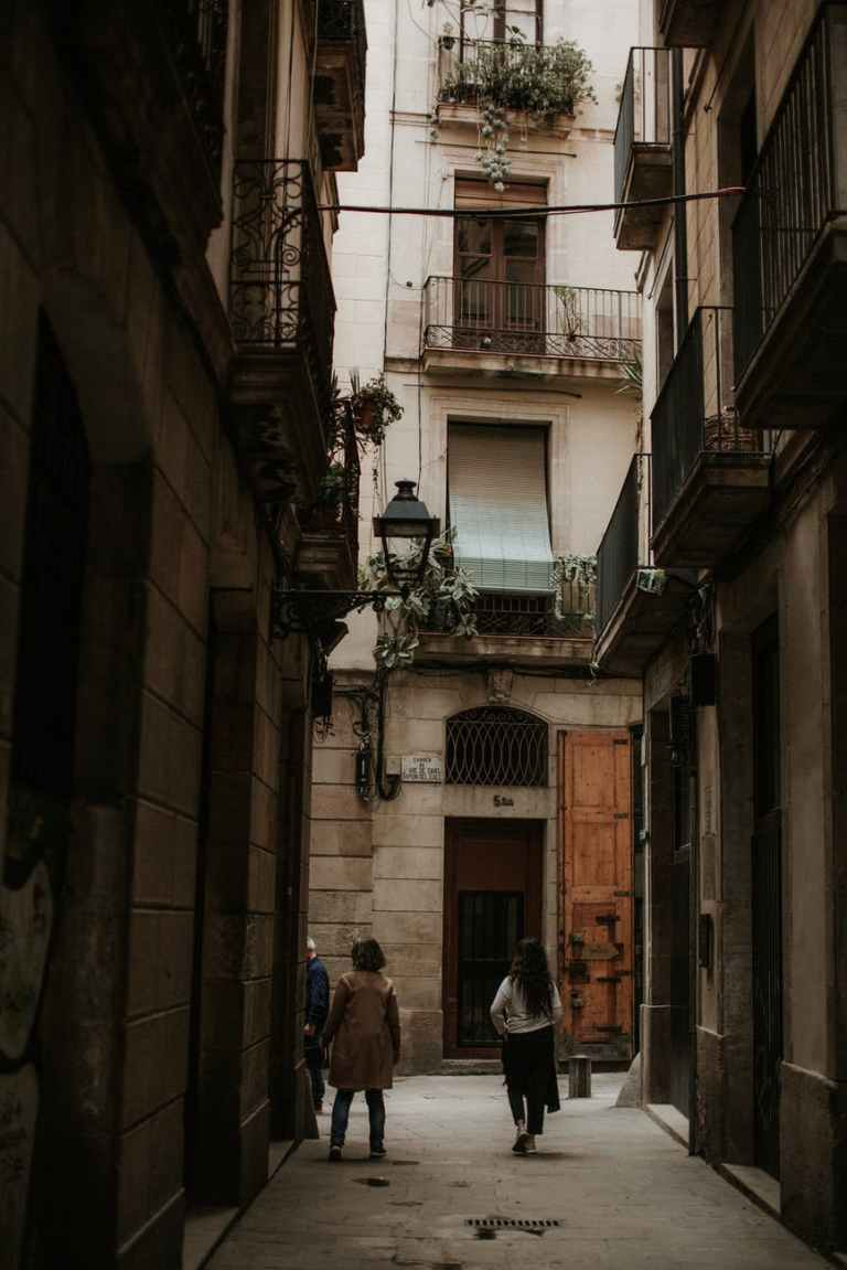 people walking in a narrow alley