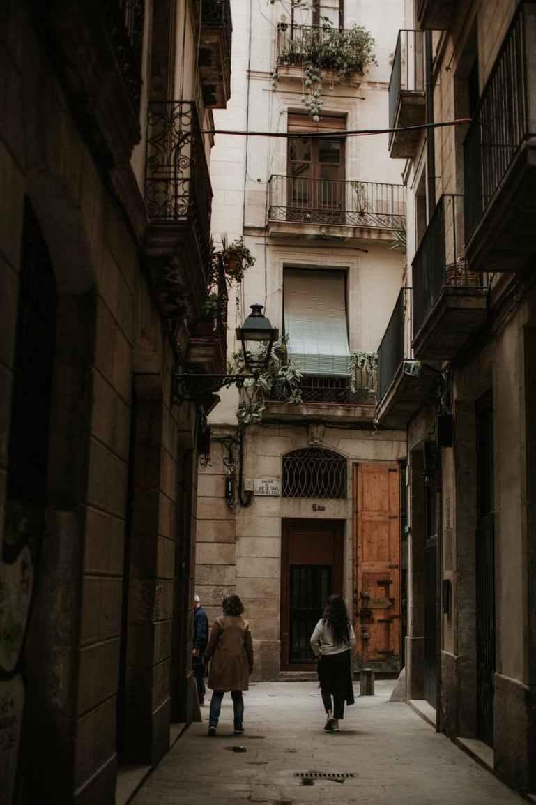 people walking in a narrow alley