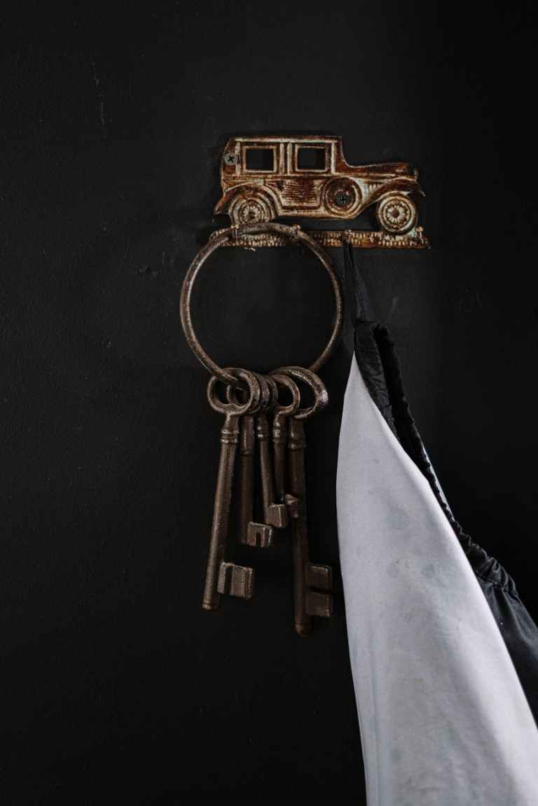 gold key holder on black wall