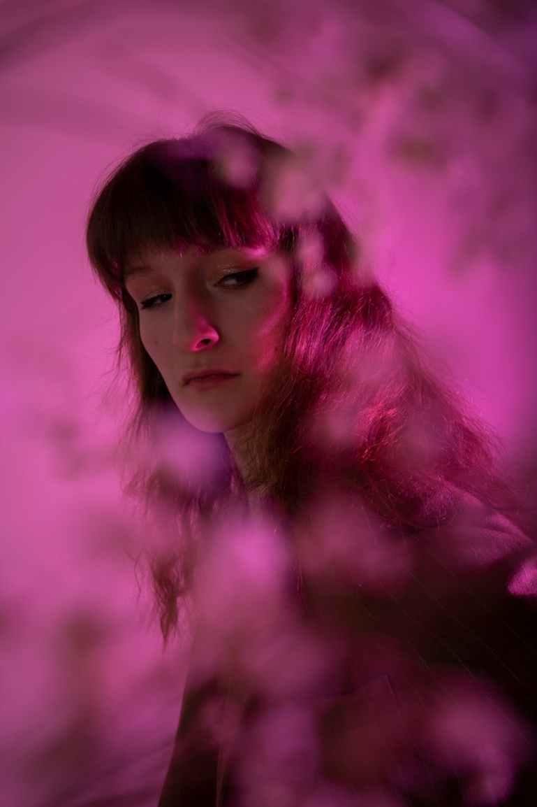 woman in pink studio