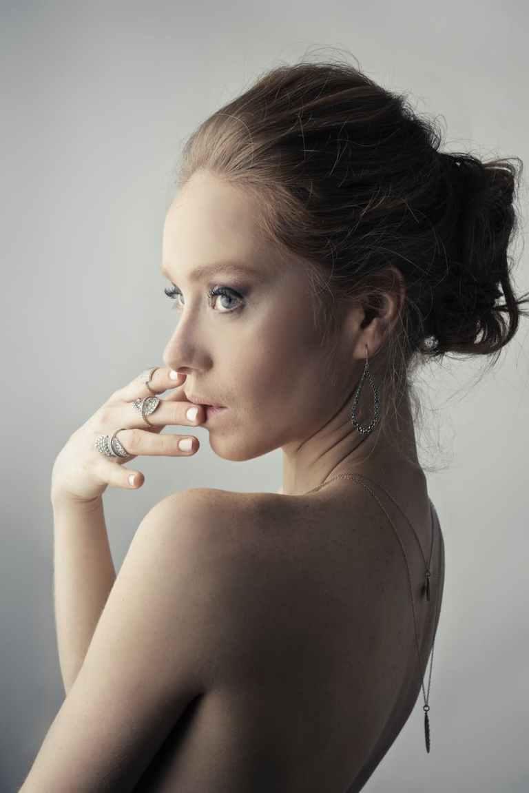 woman wearing silver colored earrings posing
