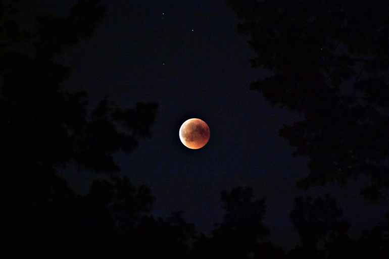 selective color photography of blood moon